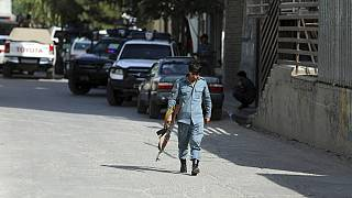 Afghan security personnel arrives at the area where the director of Afghanistan's Government Information Media Center Dawa Khan Menapal was shot dead in Kabul.