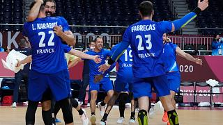 France players celebrate as they won the men's gold medal handball match between France and Denmark at the Tokyo 2020 Summer Olympics, Aug. 7, 2021.