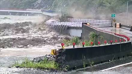 Bridge in southern Taiwan destroyed by strong floods brought on by former typhoon Lupit