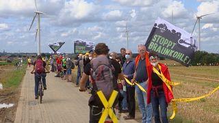 Activists form a 4-kilometer human chain around Garzweiler mine in Germany