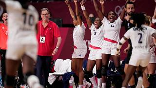 France's team players celebrate during the women's gold medal handball match against the Russian Olympic Committee at the Tokyo 2020 Summer Olympics, Aug. 8, 2021