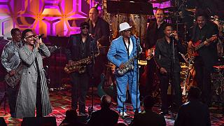 US musicians Robert 'Kool' Bell (L), James 'JT' Taylor (2nd from L), DRonald Bell (3rd from L), Dennis Thomas (5th from L) of Kool & The Gang perform onstage