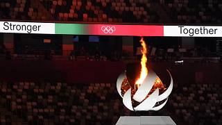 The Olympic flame burns during the closing ceremony in the Olympic Stadium at the Tokyo 2020 Summer Olympics, Aug. 8, 2021