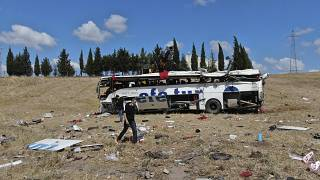 Officials investigate at the site of a bus crash, in Balikesir, western Turkey, Aug. 8, 2021.