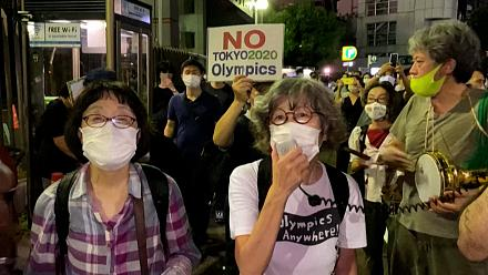 Anti-Olympics protesters gather outside Tokyo stadium