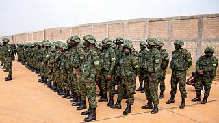 Rwandan armed forces prepare to board a flight to Mozambique