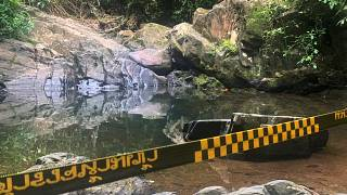 Police tape cordons off the area where a woman was found dead in Phuket, Thailand