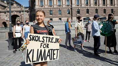 Swedish climate activist Greta Thunberg and other activists gather for a protest against climate change in front of the Swedish parliament building in Stockholm on July 2.