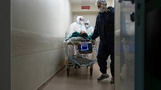Medics transport a patient with COVID-19 at the City hospital No. 52 for coronavirus patients in Moscow, Russia, July 13, 2021.