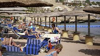 Russian tourists fly to Egypt's Red Sea resorts after years-long ban