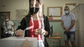 A woman casts her vote in Sofia, Sunday, July 11, 2021.