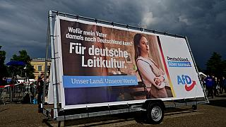 An election campaign poster with the slogan 'For German leading culture' is seen during a rally of far-right AfD party for the launch of the electoral campaign on August 10.