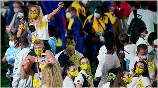 لاعبون من أستراليا في الحفل الختامي لدورة الألعاب الأولمبية الصيفية 2020 في الاستاد الأولمبي بطوكيو، الأحد 8 آب/أغسطس 2021، اليابان