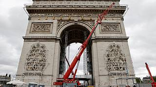 The Arc de Triomphe, home to the the tomb of the Unknown Soldier, being prepared before the wrapping of the monument, as part of a tribute for late bulgarian artist Christo.