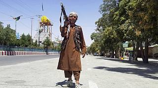 A Taliban fighter poses for a photo as he patrols in Ghazni, southwest of Kabul, Afghanistan, Aug. 12, 2021. The Taliban captured the provincial capital on Thursday.