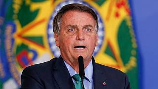 In this file photo taken on August 05, 2021 Brazil's President Jair Bolsonaro speaks during a ceremony at the Planalto Palace in Brasilia.