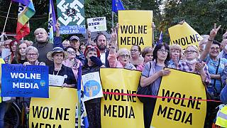 People demonstrate in defense of media freedom in Warsaw, Poland, on Tuesday, Aug. 10, 2021.