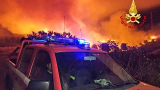 A view of a fire near Mandas, in the south of Sardinia, Italy, in the early hours of Thursday, Aug. 12, 2021