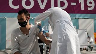A medical worker administers a shot of Russia's Sputnik V coronavirus vaccine at a Moscow vaccination centre on  July 12, 2021.