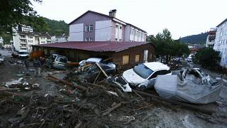 Destroyed cars in a street after floods and mudslides in Bozkurt town of Kastamonu province.