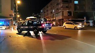 A police car patrols through Ankara's Altindag neighbourhood after the violence.