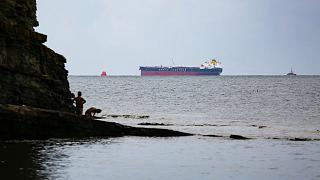 The Minerva Symphony tanker, which sails under the Greek flag is seen at the Black Sea coast after an oil spill, near Novorossiysk, Russia.