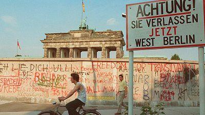 The graffiti-covered Communist wall close to the Brandenburg Gate in Berlin, sometime in 1988.