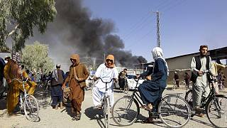 Smoke rises after fighting between the Taliban and Afghan security personnel, in Kandahar, southwest of Kabul, Afghanistan, Thursday, Aug. 12, 2021.