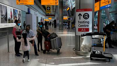 Travellers walk towards the Covid-19 testing centre at Heathrow Airport in London.