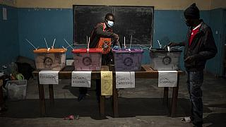 A man casts his ballot at a polling station in Lusaka on August 12, 2021 as Zambians elect their next president.