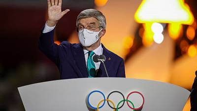 International Olympic Committee's President Thomas Bach waves during the closing ceremony in the Olympic Stadium at the 2020 Summer Olympics.