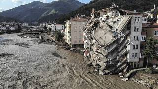 An aerial photo shows destroyed buildings after floods and mudslides killed about two dozens of people, in Bozkurt town of Kastamonu province, Friday, Aug. 13, 2021