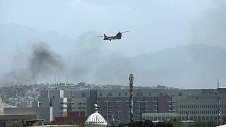 A U.S. Chinook helicopter flies over the city of Kabul, Afghanistan, Sunday, Aug. 15, 2021.