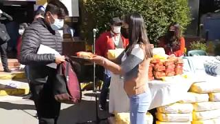 Man getting food after vaccination in El Alto, Bolivia