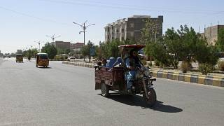 Afghans travel in motorcycle carts west of Kabul in Herat province.