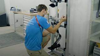 A specialist repairs a prosthetic limb in the Paralympic village in Tokyo.
