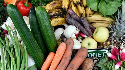 """Fruit and vegetables judged ugly by mass market retailers are pictured during """"Anti-gaspi, pour le climat aussi"""" (Fighting waste, also for climate change) in France."""