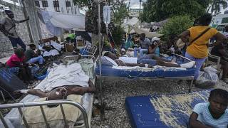 Injured people lie in beds outside the Immaculée Conception hospital in Les Cayes, Haiti, Monday, Aug. 16, 2021