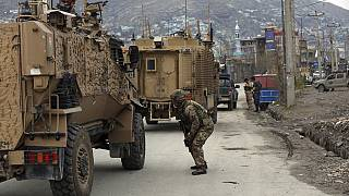 British soldiers with NATO-led Resolute Support Mission forces arrive at the site of an attack in Kabul, Afghanistan, Wednesday, March 25, 2020.