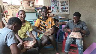 Burundian economist in transformative wood art