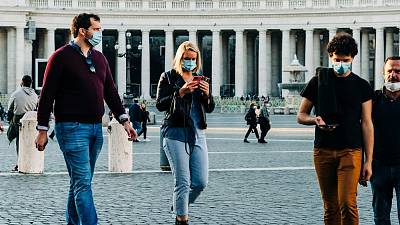 Tourists and locals wearing masks in outdoor spaces in Italy