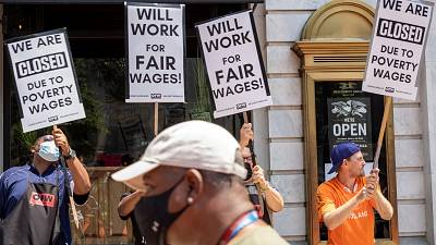 US restaurant workers protested over low pay this year, demanding to be paid the minimum wage plus tips.