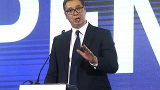 Serbia's President Aleksandar Vucic addresses the media during a news conference in Skopje, North Macedonia.