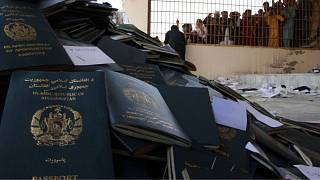 Afghans wait to collect their passports