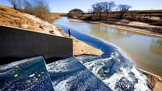 Blue dye from garment factories in Maseru, Lesotho is released into a river.