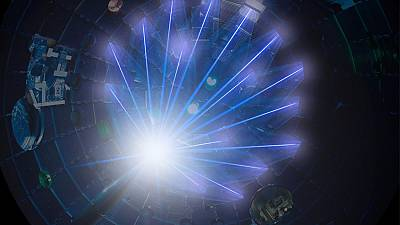 NIF's high-energy laser beams converge on a target at the center of the target chamber.