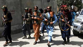Taliban fighters patrol in the city of Kabul