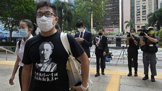 Pro-democracy activist Raphael Wong arrives at a local court in Hong Kong Thursday, Aug. 19, 2021.