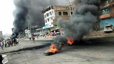 Kenya extends Covid restrictions despite protests to end curfews