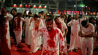 Hundreds of thousands of pilgrims thronged for the Shiite commemoration of Ashura